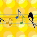 Illustration montrant des oiseaux posés sur une partition de musique