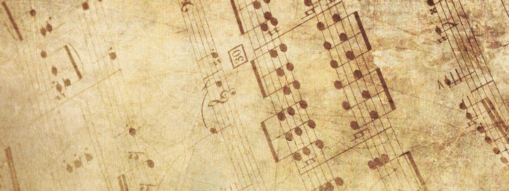 Photo représentant une partition de musique sur papier vieilli