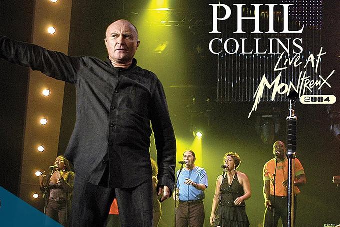 Photo représentant une photo de Phil Colins en train de chanter avec ses musiciens