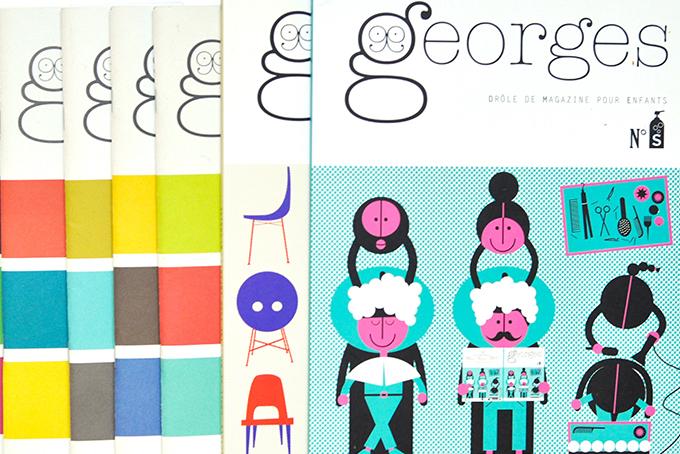 Photo représentant plusieurs magasines Georges posées les unes à côté des autres. Sur la première, on distingue une illustration rose et bleue représentant deux personnes chez le coiffeur en train de se faire laver les cheveux