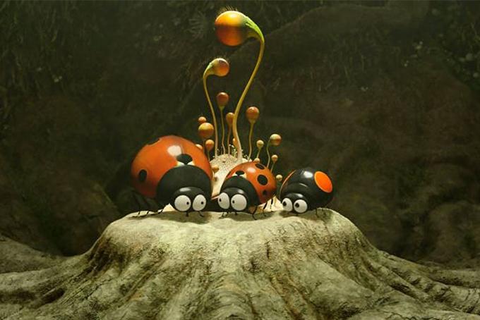 Photo représentant une photo extraite de la série d'animation minuscule où l'on aperçoit 3 coccinelles en train de discuter sur une motte de terre.