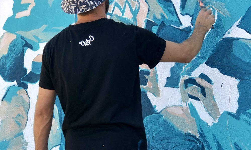 "Difuz, artiste marseillais, fait pétiller le mur de la Place Hebo avec son œuvre ""Rumbo"""