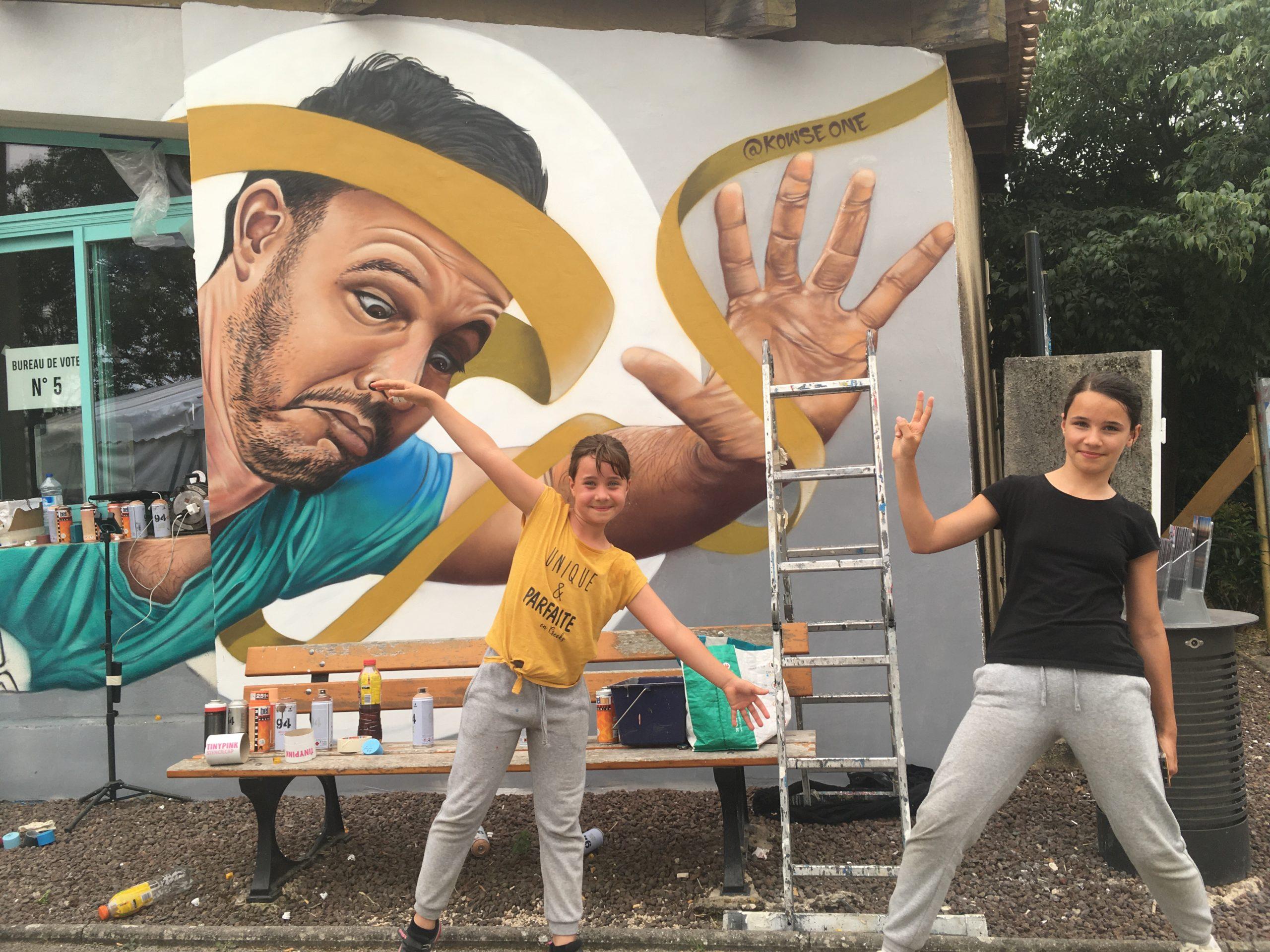 Les artistes créent au contact du public. Fresque murale réalisée par Kowse lors du Street nécessaire